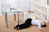 stock photo of workplace accident  - Exhausted Businesswoman Fainted On Floor At Workplace - JPG