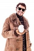picture of snowball-fight  - a young man wearing a sheepskin coat isolated over a white background playing with a snowball - JPG