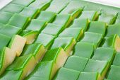 """foto of chan  - Ancient Thai sweet dessert as known""""Khanom Chan """"made from flour sugar ** Note: Shallow depth of field - JPG"""