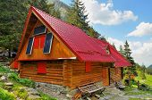 stock photo of chalet  - Mountain chalet with solar panels in Romanian Carpathians - JPG