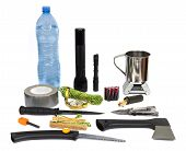 picture of survival  - Survival kit with essential emergency supplies to make food and start a fire - JPG