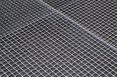stock photo of grating  - Light duty stainless steel industrial floor grating - JPG