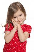 stock photo of shy girl  - A portrait of a shy preschool girl on the white background - JPG