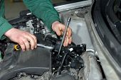 picture of grease  - Repairman holding tool and improves motor cars - JPG