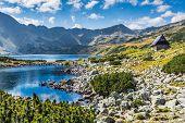 stock photo of rocky-mountains  - Mountain lake in 5 lakes valley in Tatra Mountains Poland - JPG