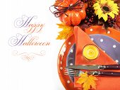 picture of thursday  - Happy Halloween or Thanksgiving party table place setting with Autumn Fall leaves pumpkin lit candle and orange and purple tableware on white background with sample text - JPG
