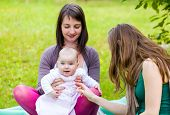 foto of babysitter  - Happy mother and daughter with her babysitter - JPG