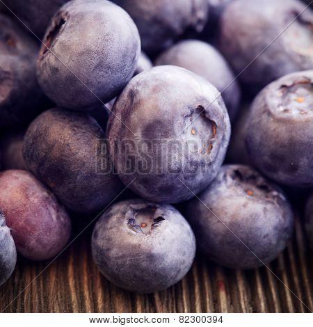 heap ripe sweet blueberries on wooden table