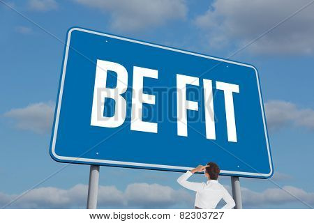 The word be fit and businesswoman scratching her head against sky