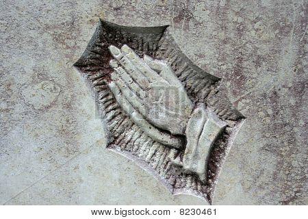 Praying Hands On A Gravestone