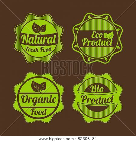 Set of four badges of natural fresh food, eco product, organic food and bio product on brown background.