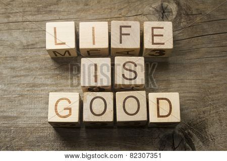 Life is Good text on a wooden background