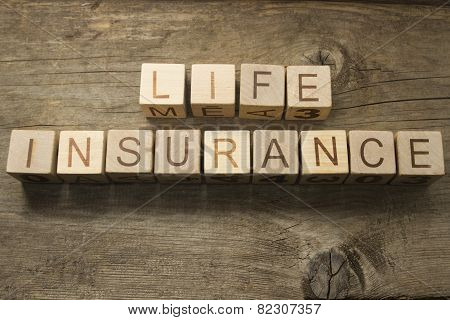 life insurance text on a wooden background
