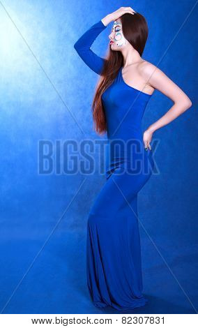 Full Length Portrait Of A Young Attractive Woman In A Long Blue Evening Dress