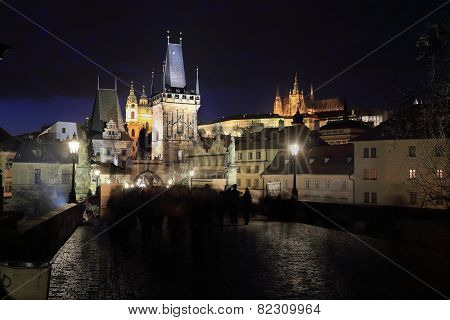 Colorful Prague gothic Castle above the River Vltava from Charles Bridge in the Night, Czech Republi