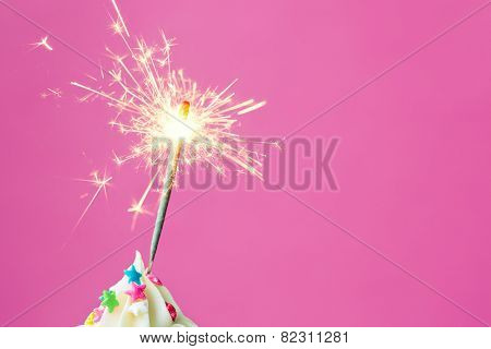 Sparkler on a cupcake with copyspace to side