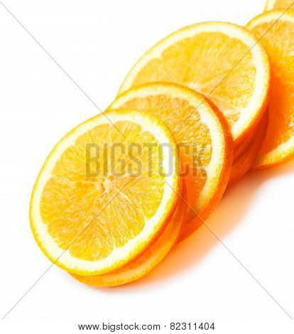 Slices Of Fresh Orange Fruit  Isolated On White Background Closeup. Stack Of Orange Slices