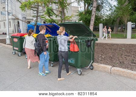 Peoples Throws Trash In The New Plastic Dumpster