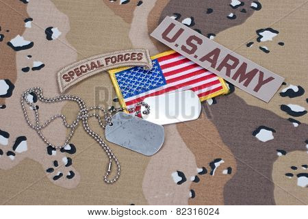 Us Army Special Forces Tab With Blank Dog Tags On Camouflage Uniform