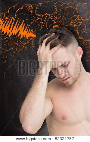 Man with headache against black background