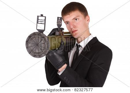 Man In Black Costume And Bazooka