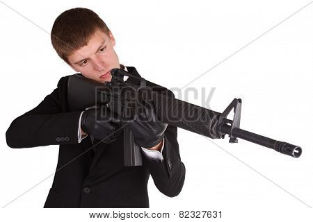 Man In Black Costume And Rifle