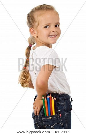 Little Girl With Lots Of Pencils In Her Pocket