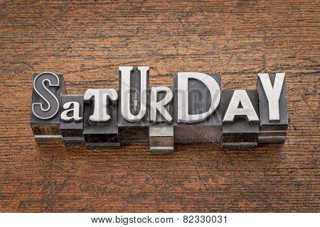 Saturday  word in mixed vintage metal type printing blocks over grunge wood