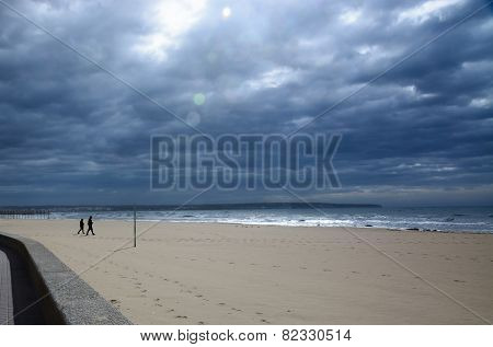Two People On Wide Beach