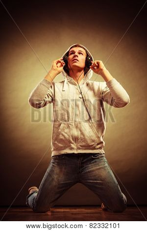 Handsome Man With Headphones Listening To Music