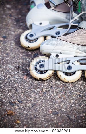 Closeup Roller Skates On Asphalt.