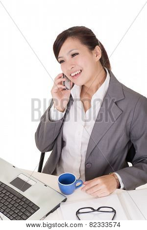Confident business woman using cellphone and sitting on chair at office on white background.