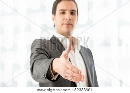 Businessman Offering His Hand In A Handshake