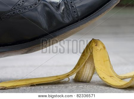 Businessman About To Slip On A Banana Skin
