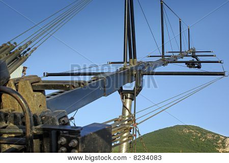 Camera On A Crane Against A Natural Landscape
