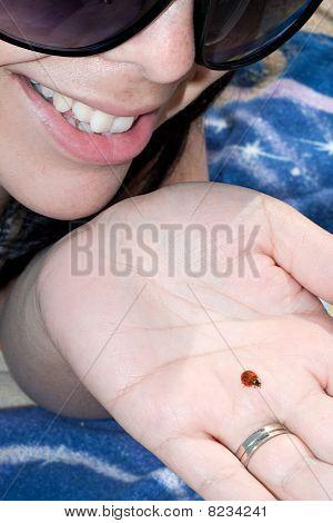 Woman Holding A Ladybug