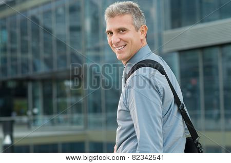 Closeup Of Cheerful Mature Businessman Looking Back Outdoor