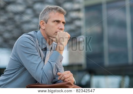 Closeup Of A Thoughtful Mature Businessman Outdoor