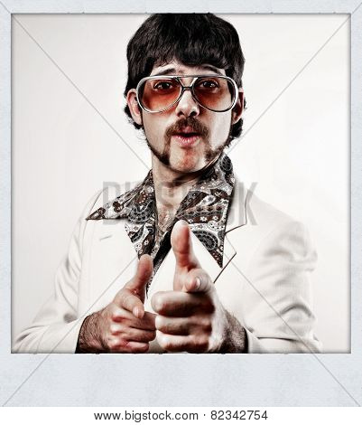 Instagram filtered image of a Retro 1970s man in a leisure suit pointing to the camera - instant film style photo