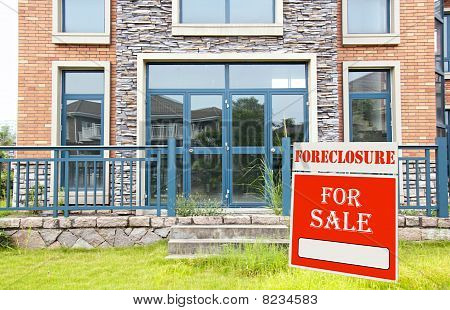 Foreclosure On Home For Sale Sign In Front Yard