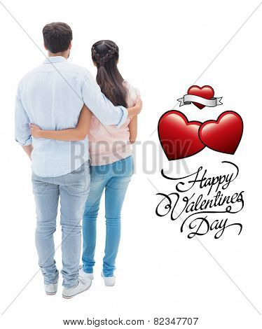 Attractive young couple standing with arms around against valentines day greeting