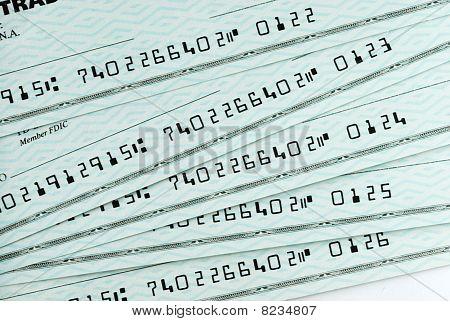 A pile of bank checks