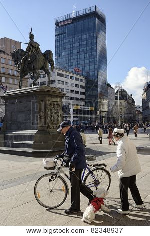 Elderly Couple And Their Cute Dog At The Ban Jelacic Square In Zagreb, Croatia.