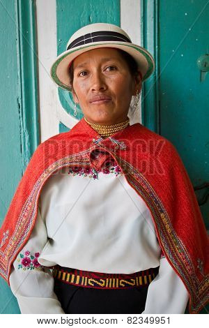 Portrait of young indigenous woman from Guaranda Ecuador wearing traditional clothing