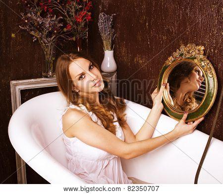 young pretty girl enjoying bath with foam