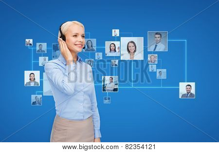 business, communication, cooperation and people concept - happy female helpline operator with headset over blue background and icons of contacts or customers