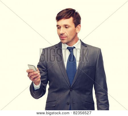 business, communication, modern technology and office concept - buisnessman with smartphone