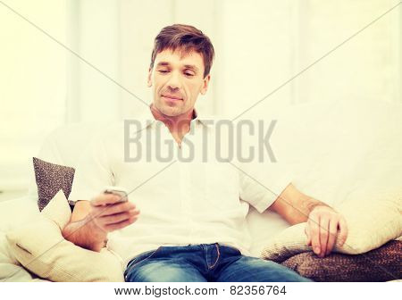 business, communication, modern technology concept - buisnessman with smartphone