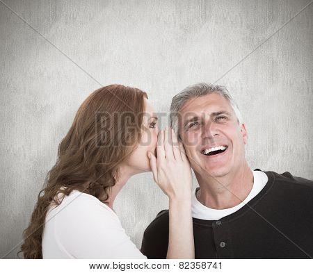Woman telling secret to her partner against white background