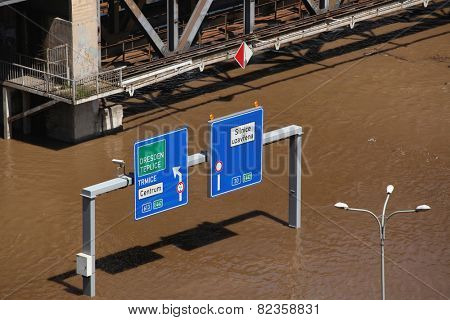 USTI NAD LABEM, CZECH REPUBLIC - JUNE 5, 2013: Traffic signs on a highway flooded by the swollen Elbe River in Usti nad Labem, Northern Bohemia, Czech Republic, on June 5, 2013.